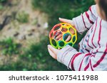 little girl holding colorful... | Shutterstock . vector #1075411988