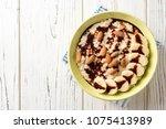 oatmeal porridge with banana ... | Shutterstock . vector #1075413989
