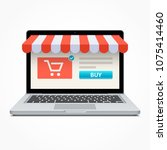 silver open laptop with and... | Shutterstock . vector #1075414460