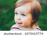 little toddler beautiful girl... | Shutterstock . vector #1075415774