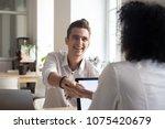 smiling happy millennial man... | Shutterstock . vector #1075420679