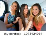 happy beautiful girls traveling ... | Shutterstock . vector #1075424084