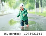 cheerful little girl walks and... | Shutterstock . vector #1075431968