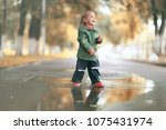 cheerful little girl walks and... | Shutterstock . vector #1075431974