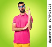 man with colorful clothes... | Shutterstock . vector #1075436228
