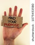 Small photo of Writing note showing Find Your Purpose. Business photo showcasing life goals Career Searching educate knowing possibilities written on Tear Cardboard Piece placed on Hand on the plain background.