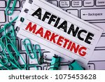 Small photo of Writing note showing Affiance Marketing. Business photo showcasing joining two or more companies in same field mutual goal written on Tear Notepad paper placed on Keyboard Clips and Paper Pins.