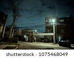 dark and eerie urban city alley ... | Shutterstock . vector #1075468049