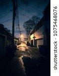 dark and eerie urban city alley ... | Shutterstock . vector #1075468076