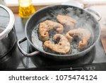pan with frying sturgeon fish.... | Shutterstock . vector #1075474124