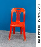 one red plastic chair on the... | Shutterstock . vector #1075477394