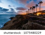 Houses Lit Up At Sunset On...