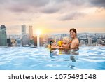 children swimming in roof top... | Shutterstock . vector #1075491548