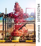 Small photo of Wellhead red color flowline pipe gate valve and steel stand