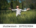 meditative man making a... | Shutterstock . vector #1075519004