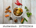 malaysian curry noodle top view | Shutterstock . vector #1075522616