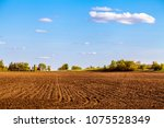american farmland with blue sky ... | Shutterstock . vector #1075528349