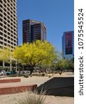 Small photo of PHOENIX, AZ, USA - APRIL 18, 2018: Palo Verde or Parkinsonia aculeata tree golden crone with blooming yellow flowers in Phoenix downtown, Arizona capital city