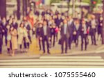 abstract blur image of people... | Shutterstock . vector #1075555460