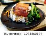 roasted suckling pig rice  | Shutterstock . vector #1075560974