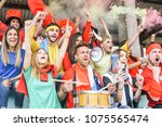 Small photo of Football supporter fans watching international soccer match - Young group of excited friends having fun exulting at soccer world game at stadium - Youth, sport and celebration score concept