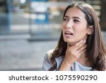 sick woman with sore throat ... | Shutterstock . vector #1075590290