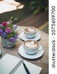 hot latte art in coffee cup on... | Shutterstock . vector #1075609700