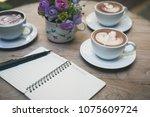 hot latte art in coffee cup... | Shutterstock . vector #1075609724