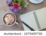 hot latte art in coffee cup... | Shutterstock . vector #1075609730