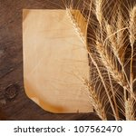 Wheat ears on vintage background - stock photo