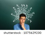 puzzled thoughtful young man...   Shutterstock . vector #1075629230