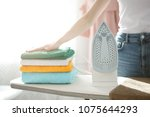 close up hand of woman ironing...   Shutterstock . vector #1075644293