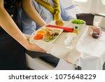 flight attendant serving a... | Shutterstock . vector #1075648229