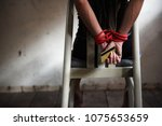 woman victim sit on  chair and... | Shutterstock . vector #1075653659