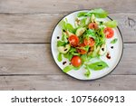 avocado and tomatoes salad with ... | Shutterstock . vector #1075660913
