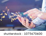 male hands using tablet on... | Shutterstock . vector #1075670600