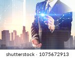 businessman pointing at glowing ... | Shutterstock . vector #1075672913