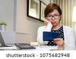 worried young asian woman... | Shutterstock . vector #1075682948