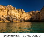 lagos caves and seashore with... | Shutterstock . vector #1075700870