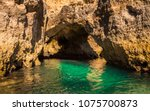 lagos caves and seashore with... | Shutterstock . vector #1075700873