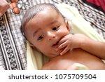 newborn baby self soothing | Shutterstock . vector #1075709504