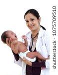 doctor woman with newborn baby | Shutterstock . vector #1075709510