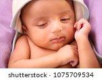 close up of newborn sleeping | Shutterstock . vector #1075709534