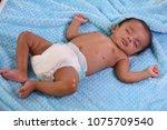 close up of newborn sleeping | Shutterstock . vector #1075709540