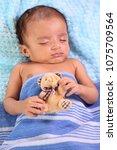 close up of newborn sleeping | Shutterstock . vector #1075709564