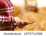 agronomist farmer using tablet... | Shutterstock . vector #1075711508