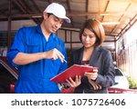 handsome mechanics in uniform... | Shutterstock . vector #1075726406