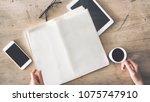 woman holding empty newspaper... | Shutterstock . vector #1075747910