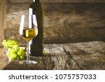 wine. glass of white wine in...   Shutterstock . vector #1075757033
