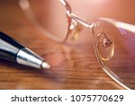 signing the contract with pen... | Shutterstock . vector #1075770629